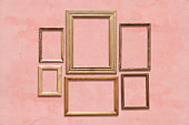 frames on pink wall