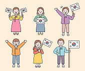 People holding the flag of South Korea.