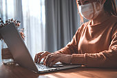 Working from home, woman working from home wearing protective mask, Corona virus.