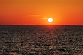 Sunset in the ocean with soft waves