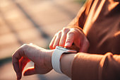 Woman using smart watches with checking pulse via health application. healthcare and people concept.