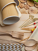 Disposable tableware from natural materials, wooden spoon, fork, knife, cup, sticks, plate, eco-friendly.
