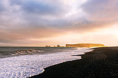Incredible sunset light and large waves on Black beach