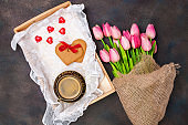 Coffee, gift and flowers on a tray. Valentine's Day. Mother's Day. Selective focus. Top view