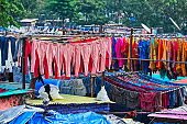 Dhobi Ghat is an open air laundromat lavoir in Mumbai, India with laundry drying on ropes