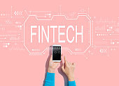 Fintech concept with person using a smartphone
