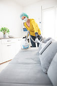 Home, apartment and room sterilization, cleaning, vacuuming with vacuum cleaner in the time of dangerous viruses.