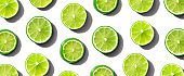Fresh green limes overhead view