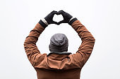 Man making heart shape symbol for love and romance.