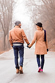 Couple enjoying outdoors in cold autumn / winter time.