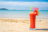 Watermelon juice in drink glass on the beach with clear day sky in Koh Kood at Trat, Thailand. Summer, Travel, Vacation and Holiday. Relax and traveling at sea concept.