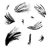 Collection of textured black ink brush strokes