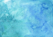 Bright emerald and blue watercolor background