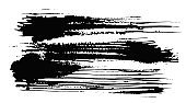 Expressive horizontal textured black ink stain