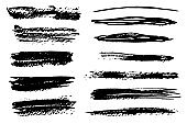 Set of isolated black textured brush strokes