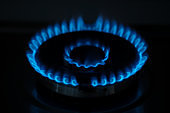 Blue flame gas in the dark. Burning gas, gas stove burner