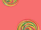 Colorful spiral candies on coral colored background (clipping path)