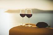 Wine glasses with red wine, Santorini island, Greece
