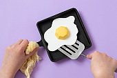 Cast-iron frying pan with paper fried eggs