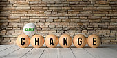 wooden balls with letters showing the words CHANGE and CHANCE in front of a brick wall - 3d rendered illustration