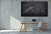 modern office with business plan doodles on a blackboard above a workplace - 3D rendered illustration