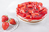 cheesecake with strawberry and fresh berries on gray table