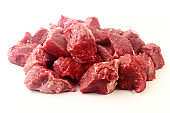 pile of diced chopped raw beef cube isolated on white background
