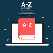 The red book A-Z glossary is depicted on the laptop screen. Above, white text is written. Dark blue background with objects.