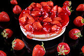 cheesecake with strawberry and fresh berries on black background