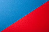 Blue and red color of paper background, texture, copy space, diagonal.