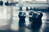 dumbbell at fitness gym. Mental health and wellness. Fit and firm for healthy. Mind-body improvements.