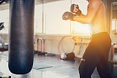 Sport man boxing at fitness gym. Mental health and wellness. Fit and firm for healthy. Mind-body improvements.