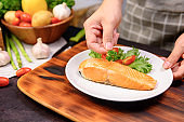 Fresh Salmon steak with salad. Online learning for cooking diet and healthy food when stay at home during Coronavirus.