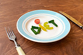 """Plate with word """"diet"""" made of vegetables."""