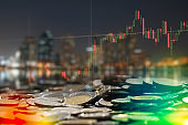 Stock market digital graph chart on LED display concept. A large display of daily stock market price and quotation. Indicator financial forex trade education background.  coins for finance and business concept