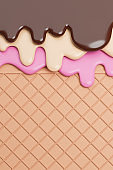 Chocolate and Vanilla and Strawbery Ice Cream Melted on Wafer Background.
