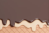 Chocolate and Vanilla Ice Cream Melted on Wafer Background.