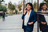 Asian businesswoman on a break having a private call