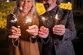 Mature couple celebrating New Year outdoors