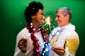 Studio portrait of two women celebrating New Year
