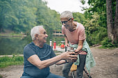 Senior couple enjoying camping by the river
