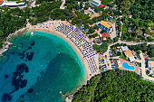 Aerial drone bird's eye view of Sarakiniko Beach with turquoise sea in Parga area, Ionian sea, Epirus, Greece
