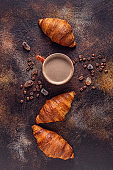 Coffee and croissant on stone background