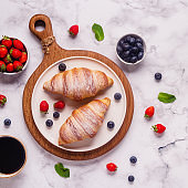 Breakfast with croissants and fresh fruits