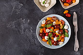 Italian caprese salad with tomatoes, mozzarella cheese, basil, olive oil