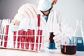Biochemistry laboratory research,Chemist is analyzing sample