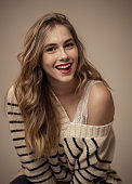 Portrait of teenager woman with perfect skin and long blond hair looking natural and beautiful.