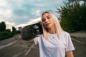 Portrait of teenage female skater