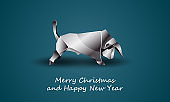 White Polygonal Bull as a Symbol of Chinese New Year. Vector Origami Ox with Metal texture on Soft Blue Background as Invitation Template for New Year Party.