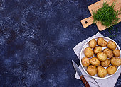 Young uncooked fresh potato and dill
